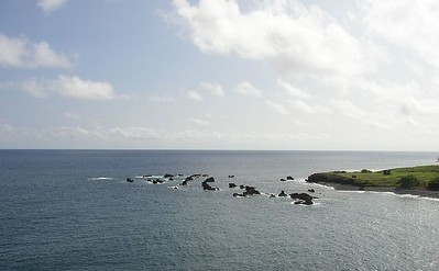 "Mokulau or ""many islets"".  These are lava outcroppings in the water."