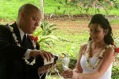 The happy couple prepare to toast each other.