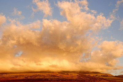 The larger of two volcanoes on Maui, this is 10,023 ft. Haleakala at the beginning of sunset, taken from our lanai.