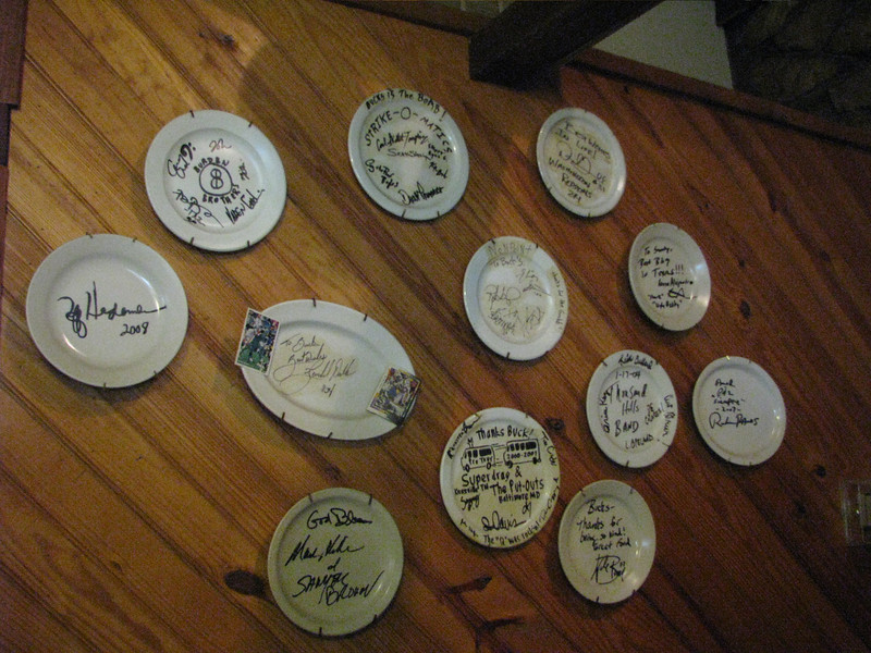 Plates of thanks from many visitors of this eatery.