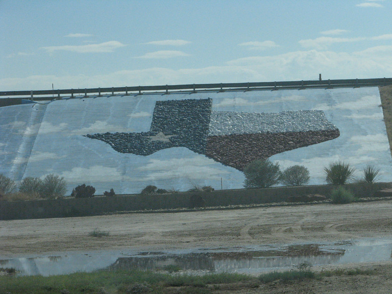 Nice display map of Texas on the freeway embankment.