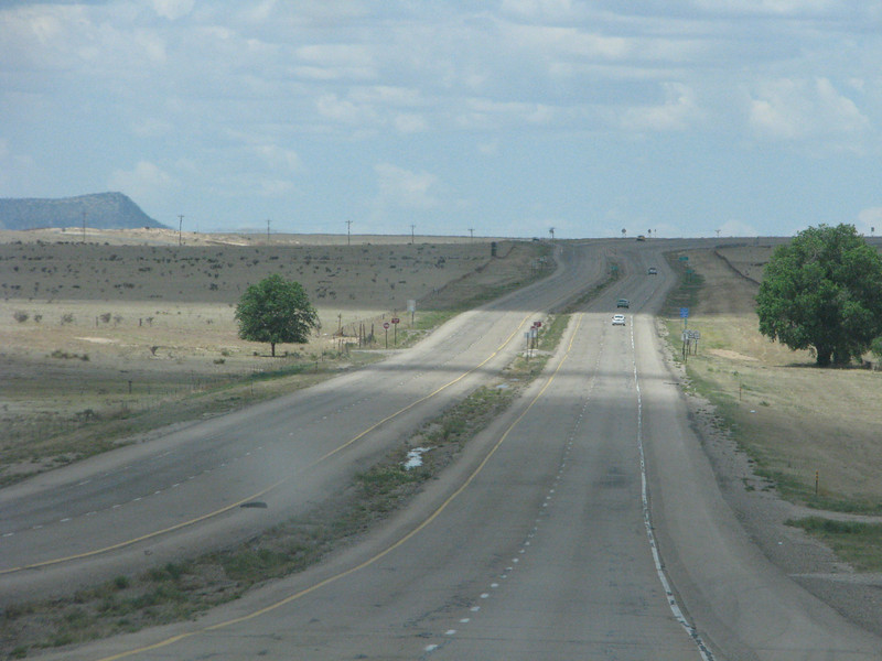 More open road with small shrubs dotting the landscape.