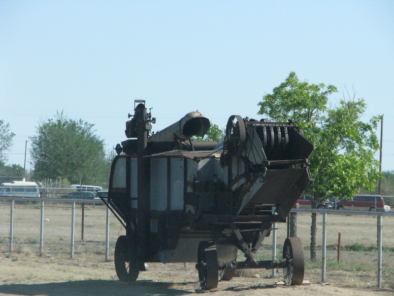 There is some old farm equipment along the hi-way at the fairgrounds.