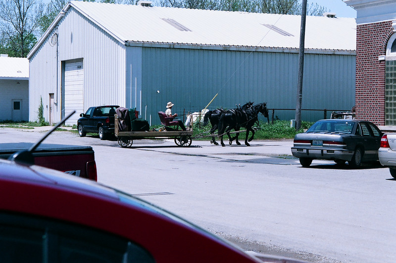Horse drawn flatbed.