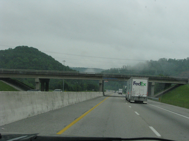 Thin veils of low laying clouds are hovering near the interstate.
