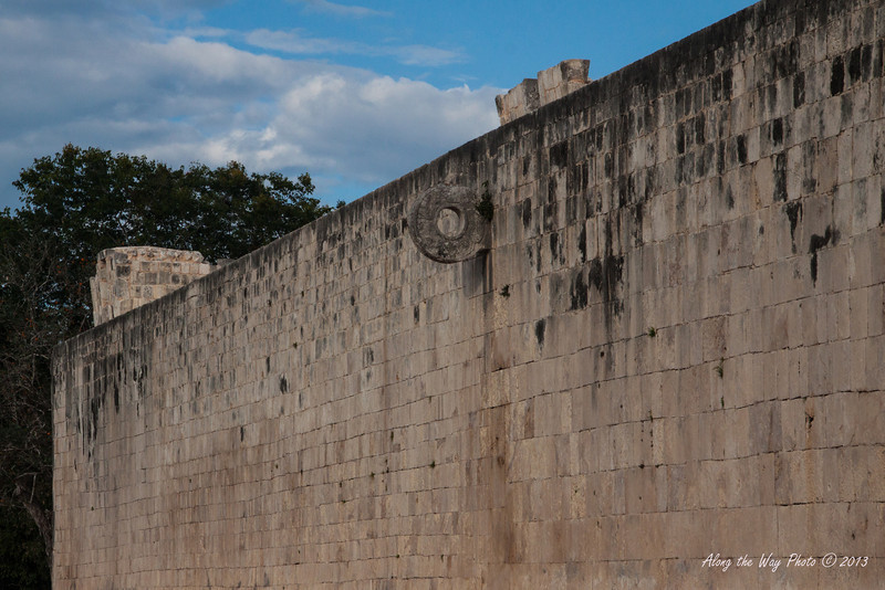 Yucatan-9618<br /> The Ball Court, at Chichen Itza, is the largest ball court in the Mayan World. The court is 551 feet long and 229 feet wide. The platforms are 311 feet long and 26 feet high with two low banked footways. The ball court had important religious and astronomic significance in the Mayan World. The ring is located in the center of the length of the wall.