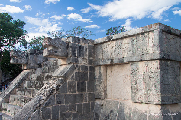 Yucatan-9614<br /> The Platform of the Eagles and the Jaguars, in Chichen Itza, is a small square base with steps on all four sides. The walls have low slopes and boards decorated with eagles and Jaguars eating human hearts
