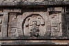 Yucatan-9702<br /> The carving in the center of the façade of the Annex of the Nuns is a Divine Lord on a celestial throne or possibly the representation of the lord Kahupakal with feathers framing him symbolizing the nature of the paradise he is in.