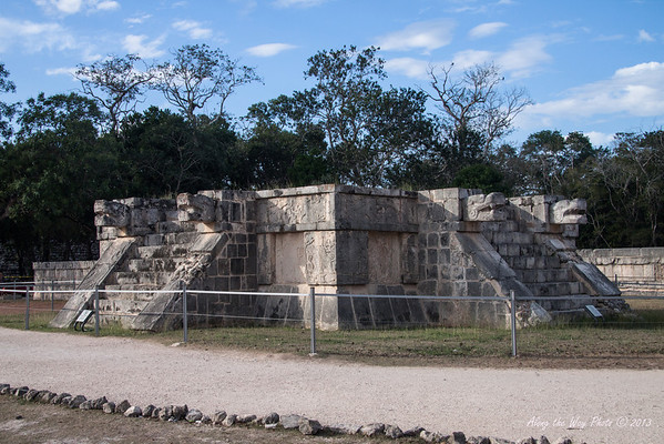 Yucatan-9612<br /> The Platform of the Eagles and the Jaguars, in Chichen Itza, is a small square base with steps on all four sides. The walls have low slopes and boards decorated with eagles and Jaguars eating human hearts.