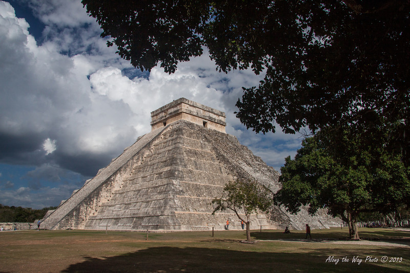 Yucatan-9591<br /> Temple of Kululkan, at Chichen Itza, is 98 feet high with the temple and has a base of 181 feet. At the Spring and autumn equinoxes the late afternoon sun hits the northwest corner causing triangular shaped shadows against the NW stairs creating an illusion of a feathered serpent crawling down the pyramid.