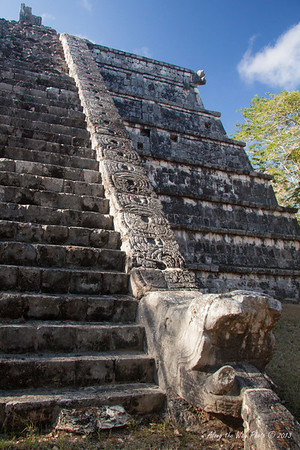 Yucatan-9691<br /> The Tomb of the Great Priest, at Chichen Itza, has a communal grave yard under its foundation. This structure has three platforms. The platform of the tombs has six columns, houses two tombs and has a frieze showing serpents.