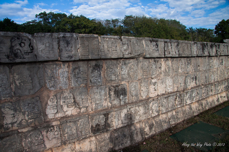 Yucatan-9616<br /> The Tzompantli, in Chichen Itza, is also known as the row of skulls. It is a platform 196 feet long and 39 feet wide and is east of the Ball Court. It was erected to exalt death as a passage to new life. On this were the skulls of captured and decapitated warriors on stakes displayed.