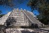 Yucatan-9686<br /> The Tomb of the Great Priest, at Chichen Itza, has a communal grave yard under its foundation. This structure has three platforms. The platform of the tombs has six columns, houses two tombs and has a frieze showing serpents.