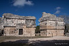 Yucatan-9698<br /> The Eastern Annex of the Nuns is a long rectangle building with three parallel galleries with eight rooms. A large Mask of Chaac is on the corners and over the doors.