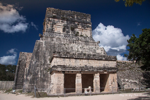 Yucatan-9742<br /> The annex of the Temple of the Jaguars, in Chichen Itza, is at the level of the plaza. It has a single vaulted chamber with two pillars decorated with reliefs. In the center opening is a beautiful throne in the form of a Jaguar, the symbol of power and royalty to the Mayans.