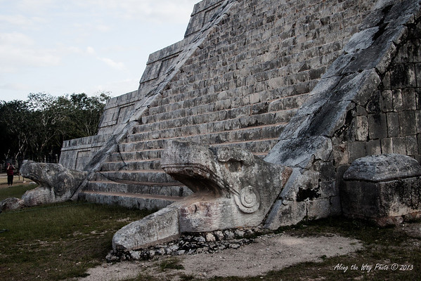 Yucatan-9610<br /> The Tomb of the Great Priest, at Chichen Itza, has a communal grave yard under its foundation. This structure has three platforms. The platform of the tombs has six columns, houses two tombs and has a frieze showing serpents.