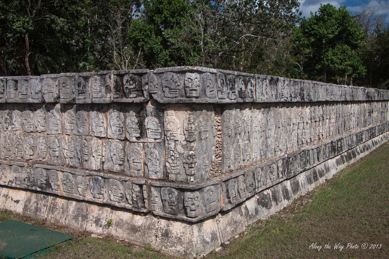 Yucatan-9741<br /> The Tzompantli, in Chichen Itza, is also known as the row of skulls. It is a platform 196 feet long and 39 feet wide and is east of the Ball Court. It was erected to exalt death as a passage to new life. On this were the skulls of captured and decapitated warriors on stakes displayed.