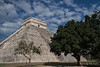 Yucatan-9598<br /> Temple of Kululkan, at Chichen Itza, is 98 feet high with the temple and has a base of 181 feet. At the Spring and autumn equinoxes the late afternoon sun hits the northwest corner causing triangular shaped shadows against the NW stairs creating an illusion of a feathered serpent crawling down the pyramid.