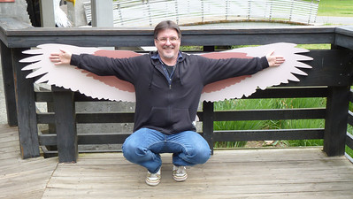 Mike matching his arms to the wing-span of an eagle.