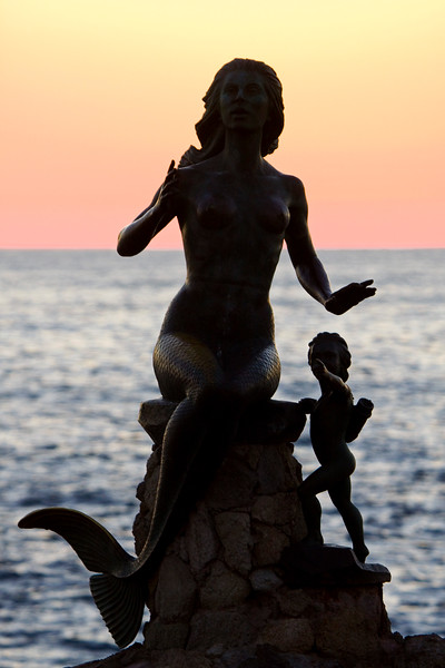 Mermaid & Child sculpture by the sea