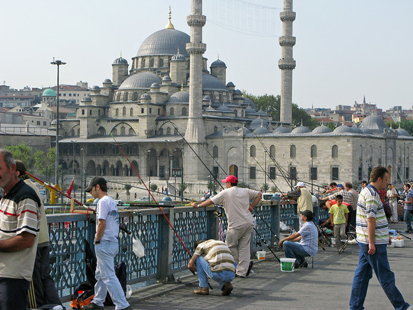 Fisherman at Gallata Bridge with New Mosque in background.