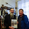 Rabbi Hassid of Gibraltar with a photo of his parents.