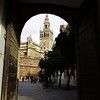 Though the gate of the Alcazar, looking at the Cathedral in Seville.