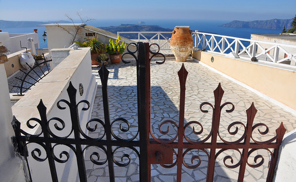 A private terrace -- someone's rooftop -- overlooking the sea. Santorini, Greece