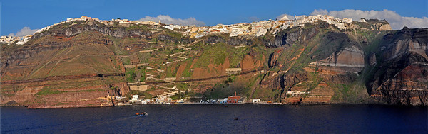 A partial view of the island and the main town of Fira. Note the zigzag path leading from the port to the town above. The houses seem glued to the hilltop.  Santorini, Greece