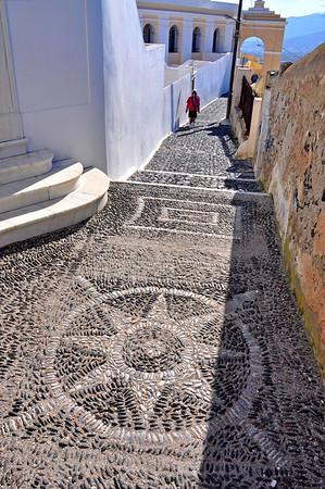 Intricate pathway designs. Santorini, Greece