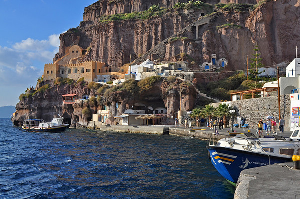 A view from our tender boat as we dock.  The people are heading towards the cable-car station and a ride to the top. Cost: 4 Euros. Santorini, Greece