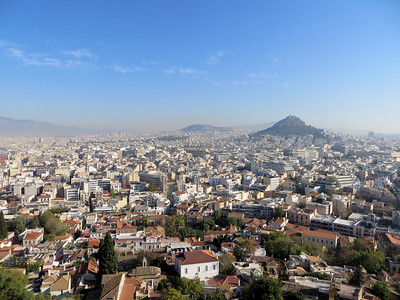 A view of Athens from the Acropolis.  Our guide told us that Athens has a height restriction on buildings so that the view of the Acropolis can never be obscured.  And you can see it floating over the city as you drive around.  (Incidentally, Athens used to suffer from terrible air pollution.  Not only was it unhealthy, it was eating away at the Parthenon and other monuments.  Our guide said that although they still had some hazy days, it was much better now than it used to be.)