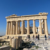 "Besides being beautiful to look at, the Parthenon is a work of architectural genius.  It was the first temple to be made entirely of marble, from a quarry about 10 miles away.  It was larger than most temples.  Its most exceptional feature is the optical illusions used to give ""an ever-so-subtle feeling of balance, strength, and harmonious beauty"" (Rick Steves.)  A long flat baseline on a building appears to be sagging, so the base of the Parthenon actually arches several inches upward in the middle to counteract this.  Parallel columns appear to bend away from each other, so these columns tilt slightly inward.  (Rick Steves says that if you extended all the columns upward for several miles, they would eventually touch.)  The corner columns are thicker to make them appear the same size as the rest.  And they bulge slightly about halfway up, giving a subconscious impression of muscular strength.  For a building that looks like it's all about straight lines, there are very few actual straight lines in it."