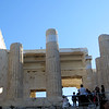 "You approach the Acropolis by way of the Propyleaea.  Designed to make an impression on the visitor, it was constructed shortly after the Parthenon was completed.  There was a large central hallway, with six Doric columns, and large side wings.  The central building looked like a ""mini-Parthenon.""  It was all originally painted in bright colors."