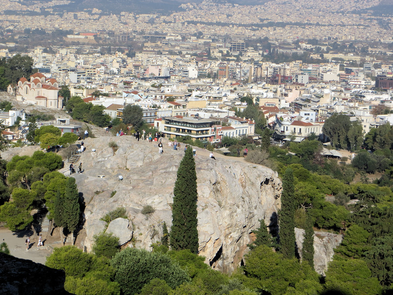 Mars Hill, or Areopagus.  It looks like a kind of rugged climb up there, but it gives you great views of the Acropolis, especially the Propylaea, the massive entry gate to the Acropolis (see later pictures).  It is said that the Apostle Paul once preached from this rock, recounted in Acts 17.