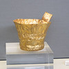 Gold drinking cup.