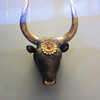 A bull or cow's head from Grave Circle A.   It is a rhyton, meaning a drinking vessel typically in the shape of an animal's head, with the opening for drinking at the bottom.