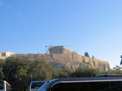 """The view of the Acropolis from the parking lot.  If you want to go """"up the hill"""" (as our guide put it), there is only one way--you have to walk.  Luckily the path is gradual and the climb is not too difficult."""