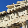 One of the most spectacular features of the Parthenon was its ornamentation.  That consisted of 3 types.  The pediments (the triangular parts atop the east and west fronts)  depicted parts of Athena's life story.  Below the pediments, as you can see here, were rectangular panels called metopes, showing scenes from mythic battles.  There were originally 92 of them, mostly designed by the renowned sculptor Pheidias.  Inside the outer temple was an inner room called the cella.  Around the columns of this room was a 525 long frieze that circled the building.  It showed an elaborate procession with more than 600 participants--men, women, musicians, sacrificial animals.  Scholars don't all agree on what kind of procession it was.  Some believe it to be the Panathenaic parade that was held every four years.  All of this would have been brightly painted.
