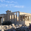 The Parthenon is not the only beautiful building on the Acropolis.  Across from the north face of the Parthenon is this building, the Erechtheion.  It was built between 421 and 406 B. C.  It is named after a mythical Athenian king, Erechtheus, and housed a wooden cult statue of Athena.  (Note:  there were two other statues of Athena on the Acropolis in ancient times.  One was a gigantic gold and ivory statue inside the Parthenon.  The other was a 30-foot high statue that stood between the Propylaea, or entrance gate, and the Erechtheion.  It showed Athena in armor as the defender of her city.  It was said to be so tall that ships at sea could see the shining tip of her spear.)  I believe the tree that is visible next to the building represents a sacred olive tree which the ancients believed was a gift from Athena.