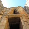 """The tomb is built into the side of a hill.  The entranceway is deep and roofed by two enormous blocks, or lintels.  The innermost of the two is believe to weigh about 120 tons.  Above the lintel we can see a """"relieving triangle"""" like the one on the Lion Gate."""