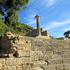 """Partway up  Kronos Hill, which runs alongside the Temple of Hera, are the remains of  a row of small temple-like structures called """"the treasuries.""""  They were donated by various city states and housed precious treasures .  These buildings attest to the fame of the sanctuary all over the Greek world."""