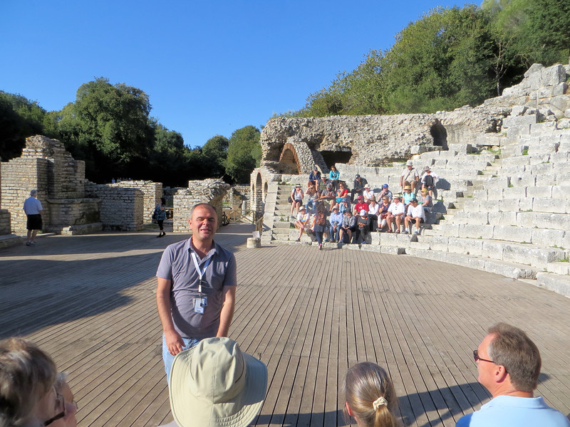 This is our guide talking to us in the theater.  The floor obviously is modern.  I have seen earlier photographs of the theater which show that there is water underneath the floor.  In the background, just past where those people are sitting, you can see the arches of a shrine to Asclepius, the god of healing.  A cult of his followers lived in Butrint.