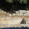 The larger stones were part of a very ancient wall; the wall with the smaller stones is Roman.