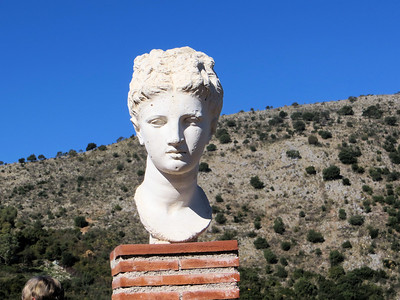 A head of Apollo mounted on a pedestal in the rest area.  This is a reproduction.