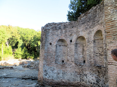 A wall from a large residence known as the Triconch Palace.    It was probably built in the 4th century.