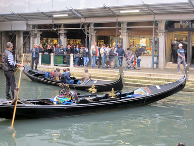 Gondolas are iconic in Venice and I must admit they really look cool.  When I got home I Googled them and learned a lot of interesting stuff.  They must be painted black (per a law passed hundreds of years ago).  They are 35 feet long and weigh 1500 lbs.  They are flat bottomed and slightly asymmetrical.  A gondola is rowed (not punted) with a single oar.  The strange curvy piece of wood next to the oar is the oarlock.  The prow of a gondola is a standard shape.  The curved top is said to represent a doge's cap and the six horizontal strips (like the teeth of a comb) represent the six districts of Venice.