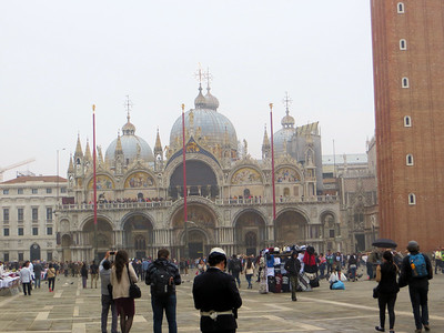 St. Mark's Basilica is reputed to hold the remains of St. Mark.  In fact the church was originally built to house this relic and even now, supposedly, it is under the altar.  This church was built in the 11th century, replacing an earlier one that burned down.  The architecture is sort of a blend of East and West, with its onion domes, elaborate ornamentation, and mosaics.