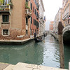 "When you get away from the Grand Canal, you are in a maze of smaller canals like this one, crossed by bridges like the one you can see in a distance, as well as narrow pedestrian walkways euphemistically called ""streets"" that are lined with shops and restaurants."