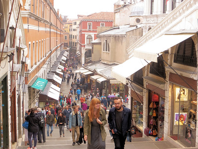 On the steps leading up to the Rialto Bridge.